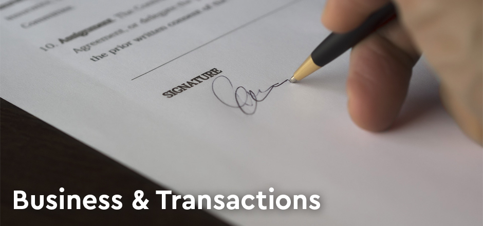 Hang signing a contract - Oberg Law Group Business and Transactions